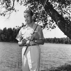 Edward R. Murrow with fishing rod