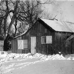 Shack in winter from front