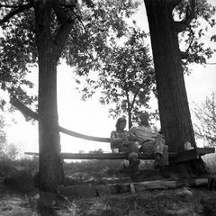 Aldo and Estella Leopold on slide hill bench