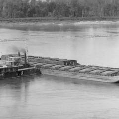 Aerial view of the S.S. Thorpe moving barges off sandbar
