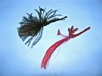 Two feather and bug ornaments