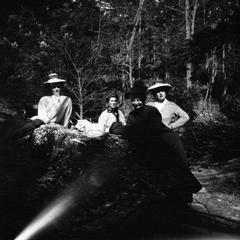 Women posed at rock in the forest