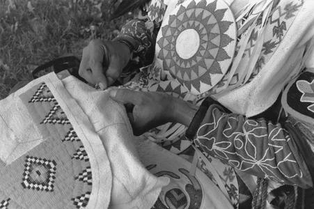 Gerald Hawpetoss sews a beaded moccasin vamp