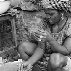 Woman Painting Metal Buckets