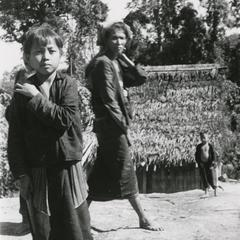 A young boy and woman in a Black Lahu (Lahu Na) village in Houa Khong Province