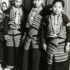 Four Yellow Lahu (Lahu Shi) young women stand in traditional dress in the village of Nam Kheung in Houa Khong Province