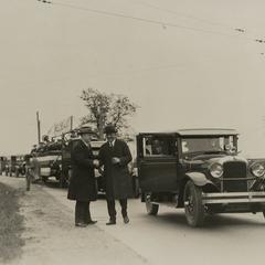 Charles W. Nash leads a parade of Nash automobiles