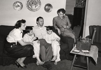Aline Hazard interviews a family