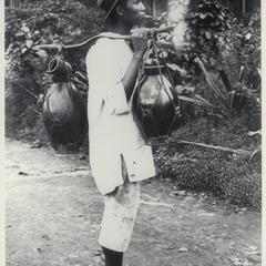 Carabao milk peddler, Manila, early 1900s