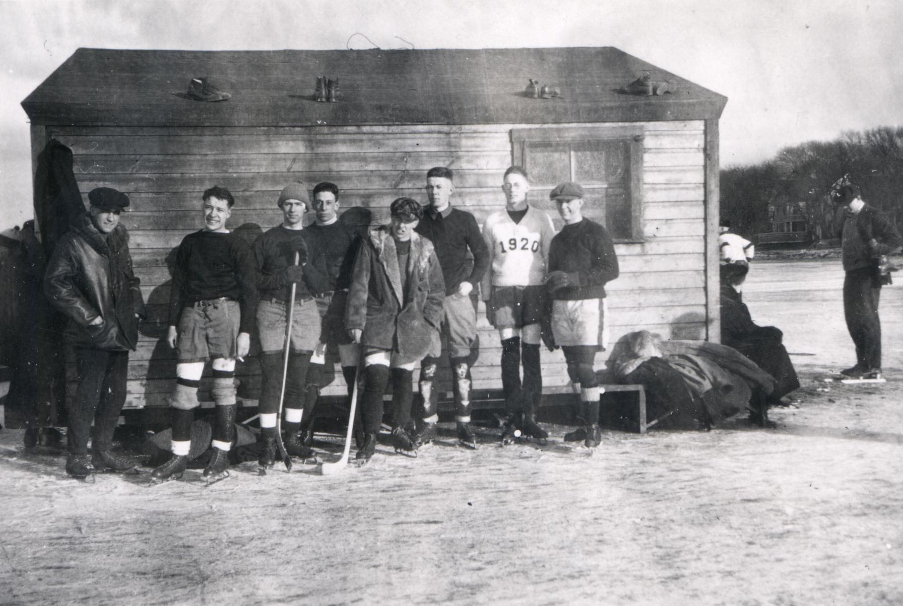 Hockey team by ice hut