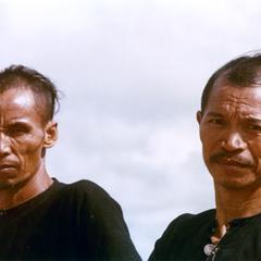 Two Lanten men pose near the village of Chommok in Houa Khong Province