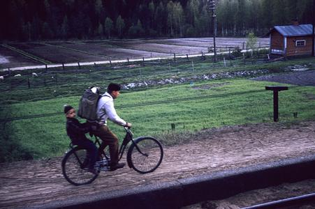 Man and child on bike