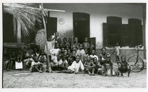 Children in front of house