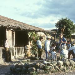 Iltis with teosinte stalk and locals outside of El Progreso