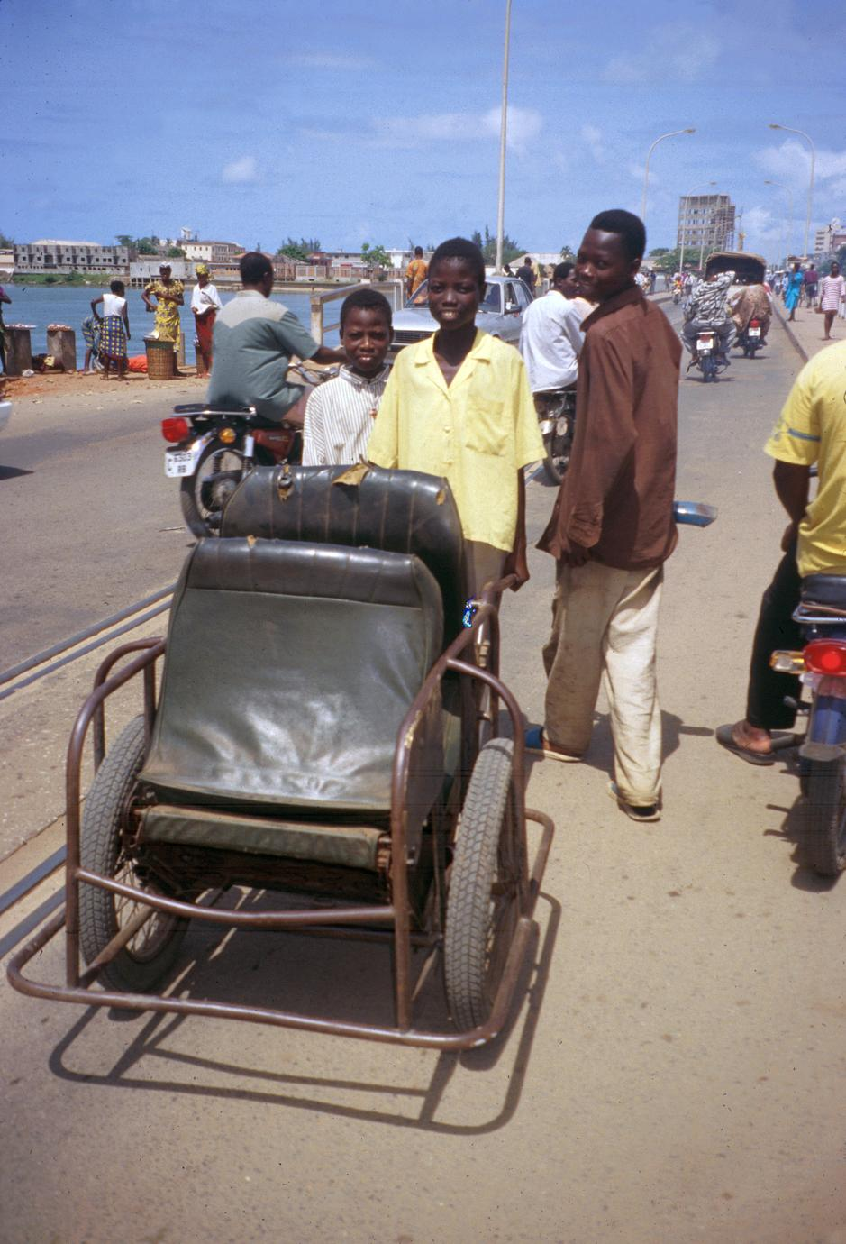 Boys with Cart (Pousse-Pousse) for Tranport
