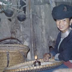 A White Hmong girl inside a house in Houa Khong Province