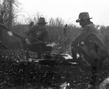Aldo Leopold and Starker Leopold at campfire in Missouri