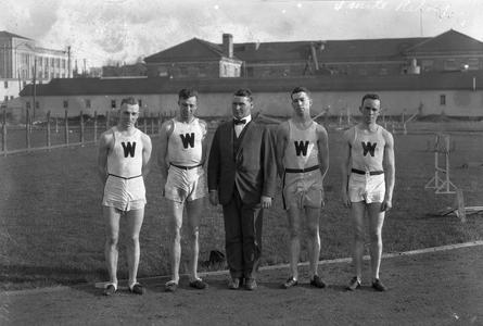 UW track team members and coach