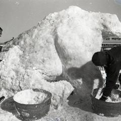 Students working on a snow sculpture