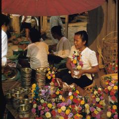Lao women--selling artificial flowers