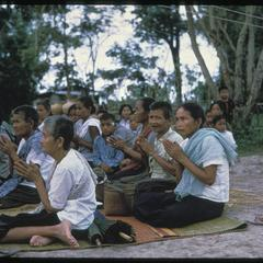 Ban Pha Khao : villagers praying (note : segregation of sexes, male privacy)
