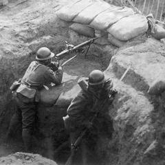 Japanese soldiers in a trench.