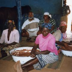 Jim Stills with shea butter makers