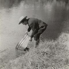 Warden planting fish