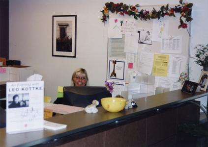Administrative assistant Judy Benike at her desk