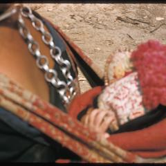 Hmong (Meo) spectator with baby