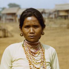 Nyaheun wife of the village chief poses in a village in Attapu Province