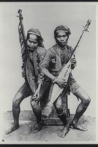 Two musicians in traditional clothing, ca. 1920-1930
