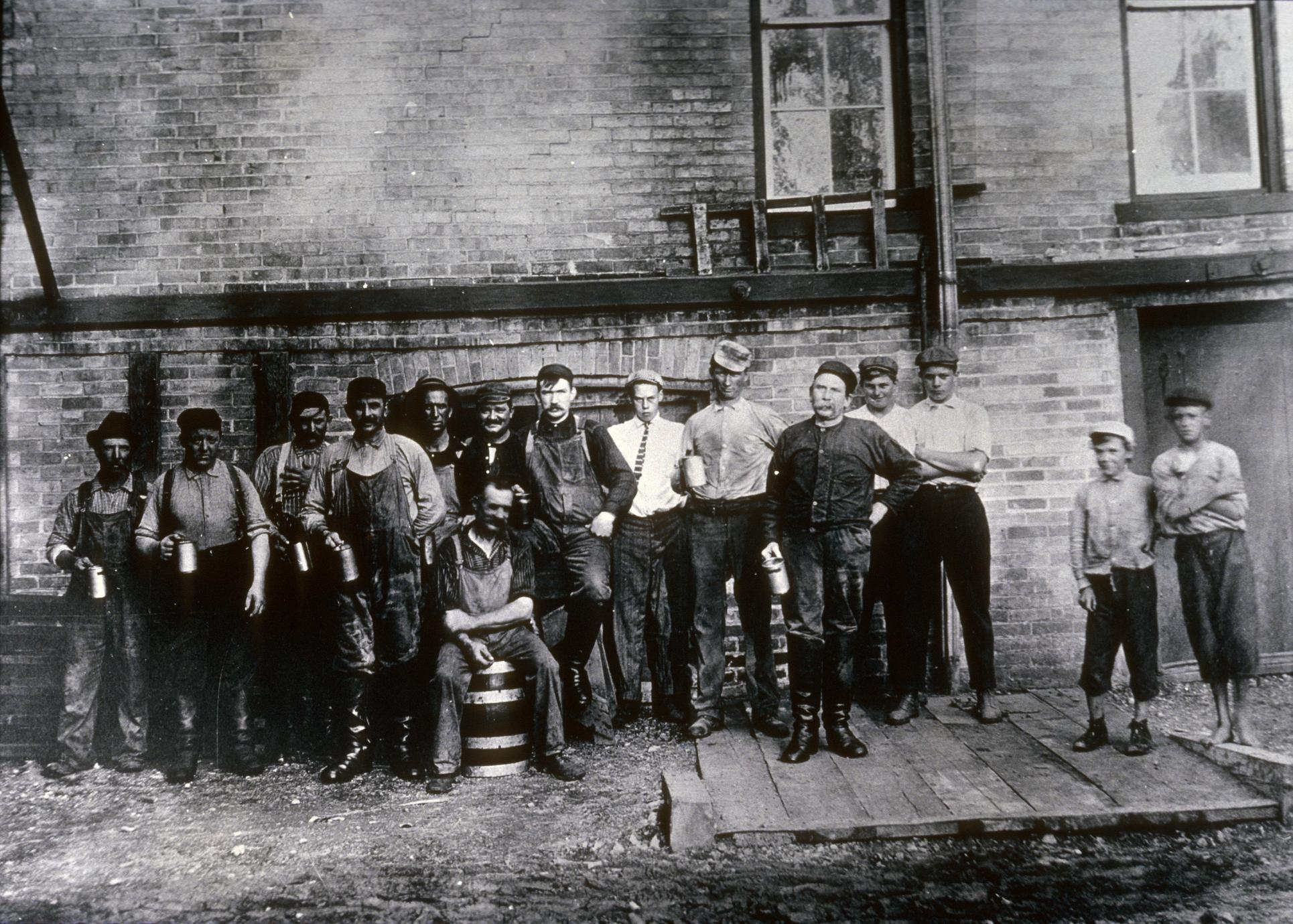 Brewery workers with beer glasses