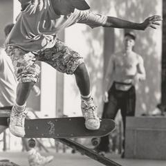 Skateboarding down the railing