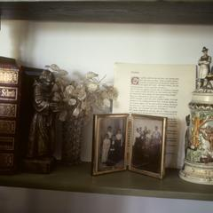 Bible, beer stein, and family portrait on mantelpiece