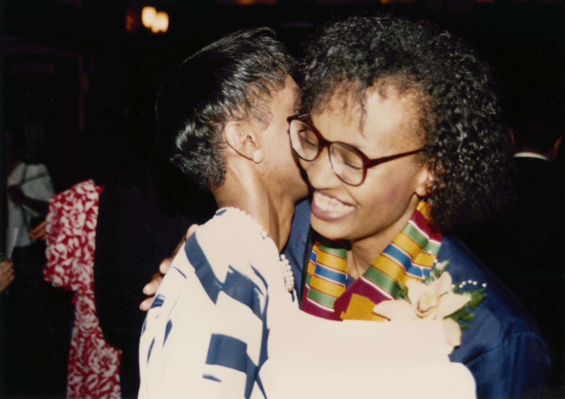 Students hugging at Multicultural Reception and Awards ceremony in 1990