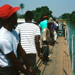 People Hand-pulling the Ferry Across the Gambia River at Bansang