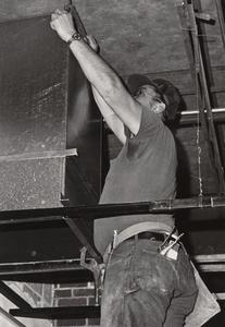 Construction worker working on the Wells Culture Center, Janesville, 1982