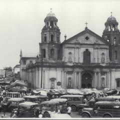 Army vehicles in front of Quiapo Church, Manila, 1946