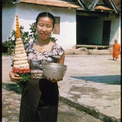 Khamphouy with offerings at a pagoda on the Lao New Year
