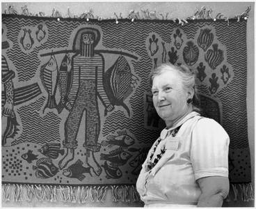Helen Louise Allen in front of a tapestry