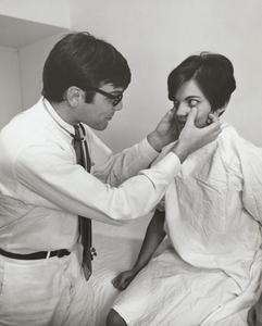 Ophthalmologist examines patient