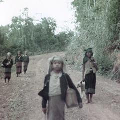 Five Nyaheun women walking on a road in Attapu Province