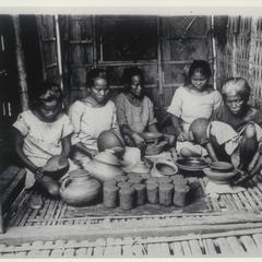 Women working pottery, Ilocos Norte, 1927