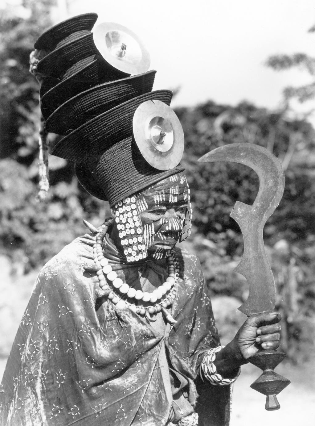 Ekonda Political Leader (Nkumu) Posed with Knife of Honor for Colonial Press