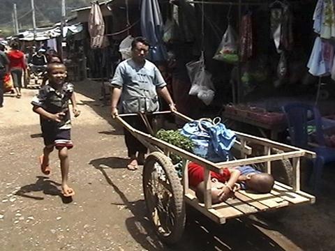 Man carting two kids