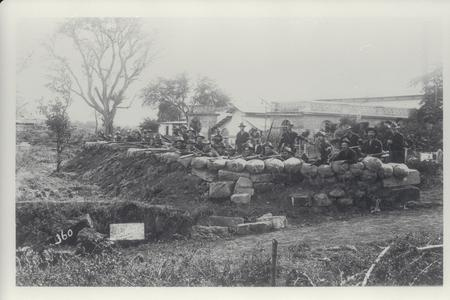 Company of American soldiers dug into defensive position at the Antohan pumping station, 1899
