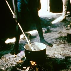 "Stirring Cassava (Manioc) Flour in Boiling Water to Make ""Luku"" (Porridge)"