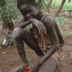 Orphaned Boy with Meal
