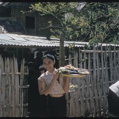 2500th Anniversary of Buddhism- girl bringing feast